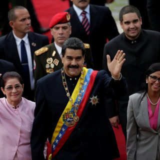 Venezuela's President Nicolas Maduro, his wife Cilia Flores and National Constituent Assembly President Delcy Rodriguez, wave as they arrive for a session of the assembly at Palacio Federal Legislativo in Caracas