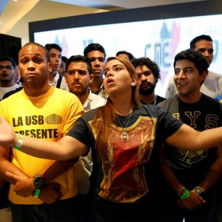 Opposition supporters react while listening to the results of the nationwide election for new governors, at the campaign headquarters of the Venezuelan coalition of opposition parties (MUD) in Caracas, Venezuela October 15, 2017. REUTERS/Carlos Garcia Rawlins