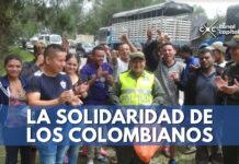 Policía Popayán dan comida a venezolanos